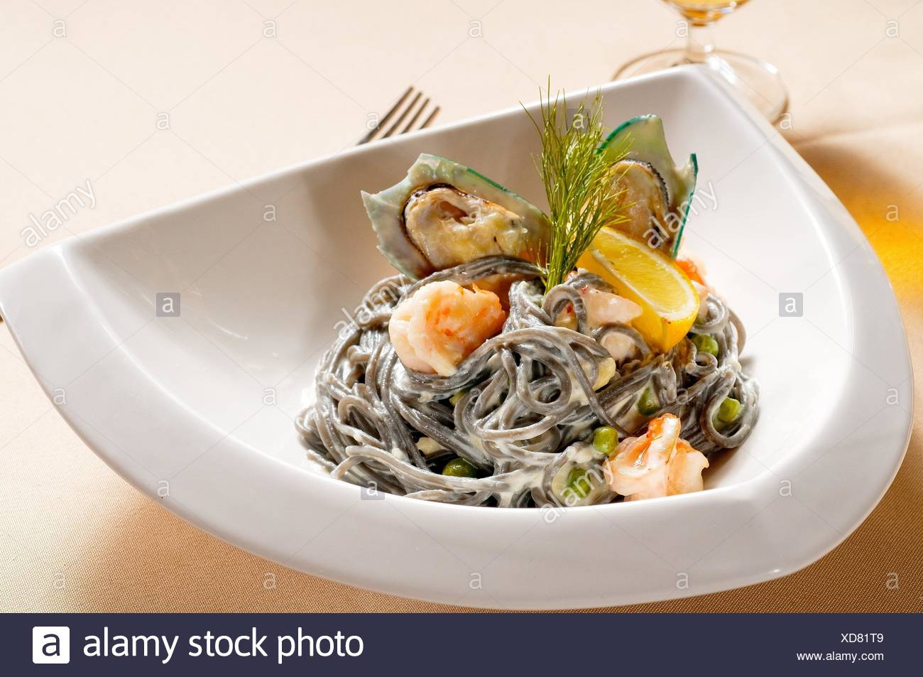 fresh seafood black squid ink coulored spaghetti pasta tipycal italian food. - Stock Image