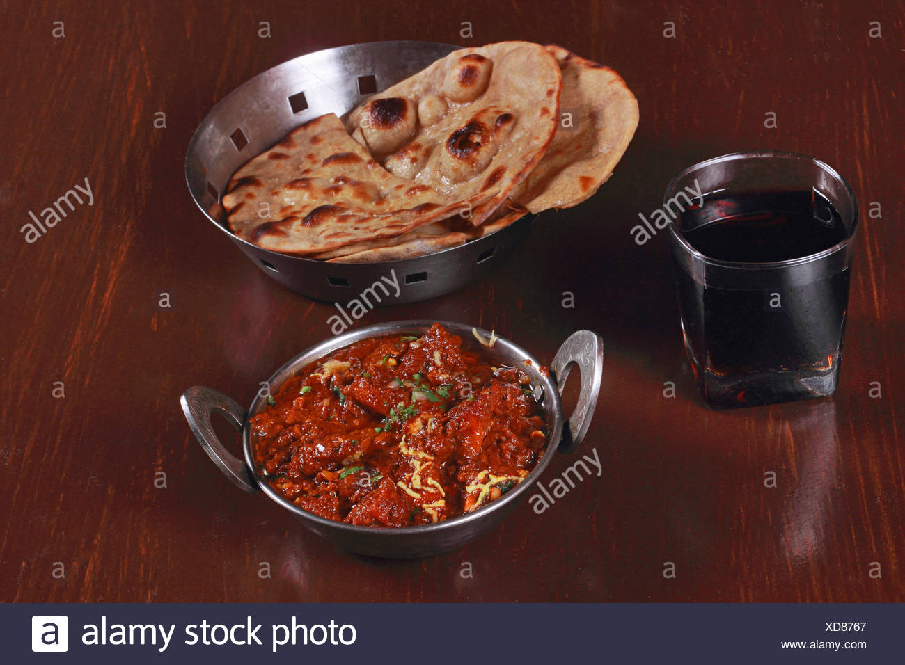 Indian meal , Chicken Curry and Roti bread - Stock Image