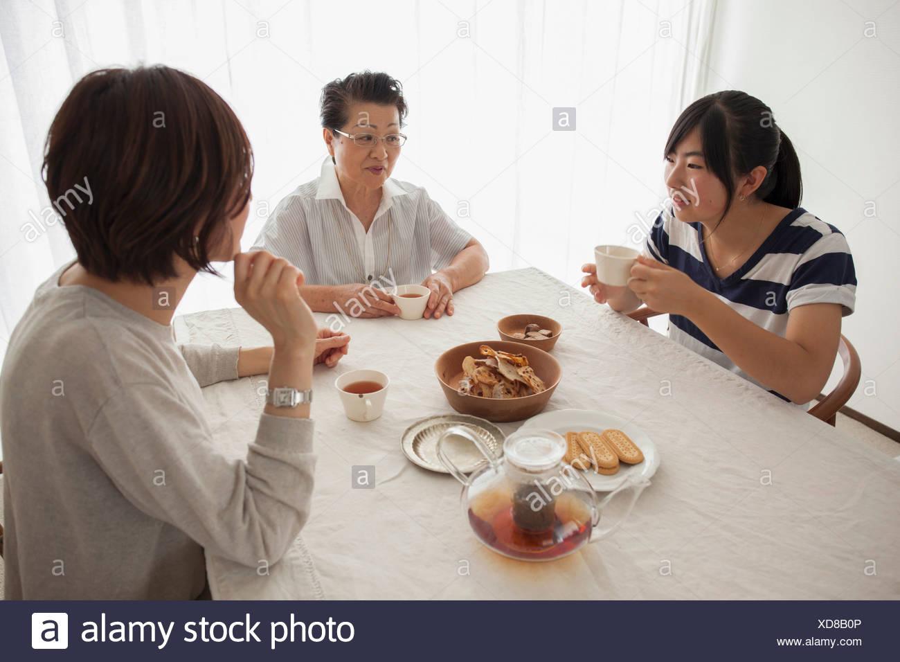 Three generation family at table - Stock Image