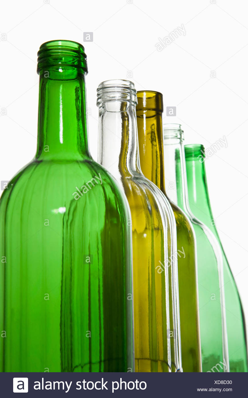 A row of recyclable glass bottles - Stock Image