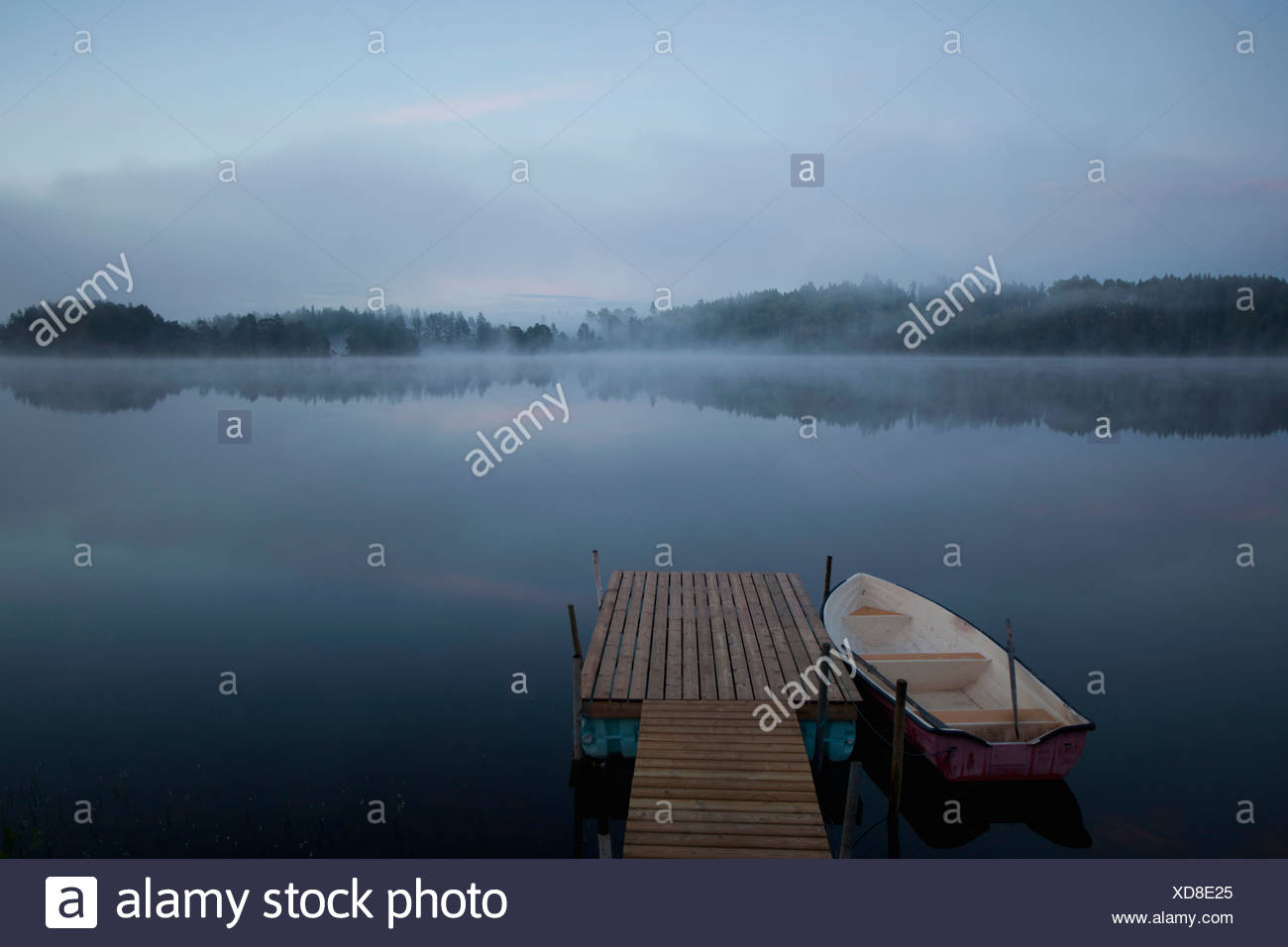 Beautiful view of pier with boat - Stock Image