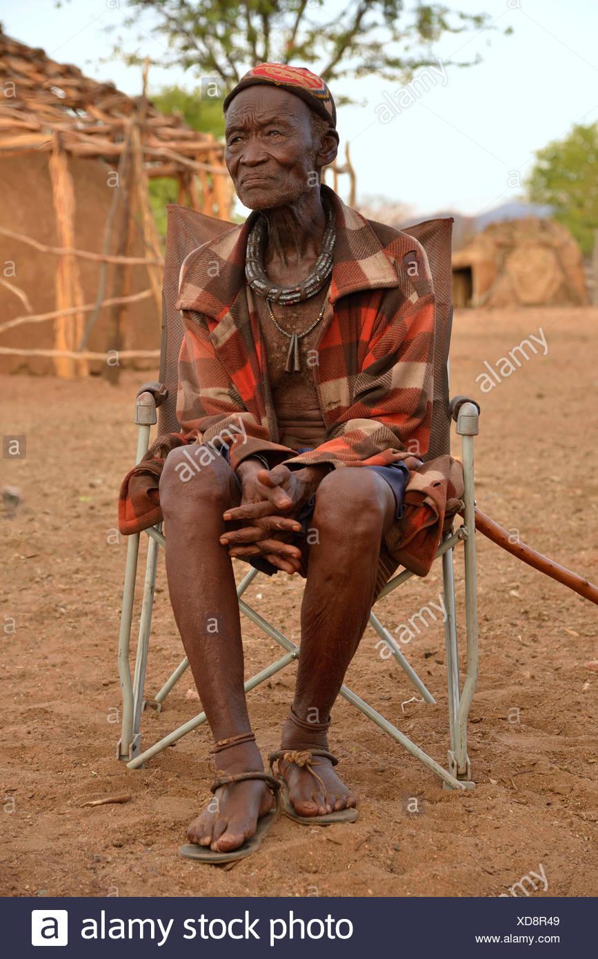 Chief Hikuminue Kapika, chief of the Namibian Himba, in his kraal - Stock Image