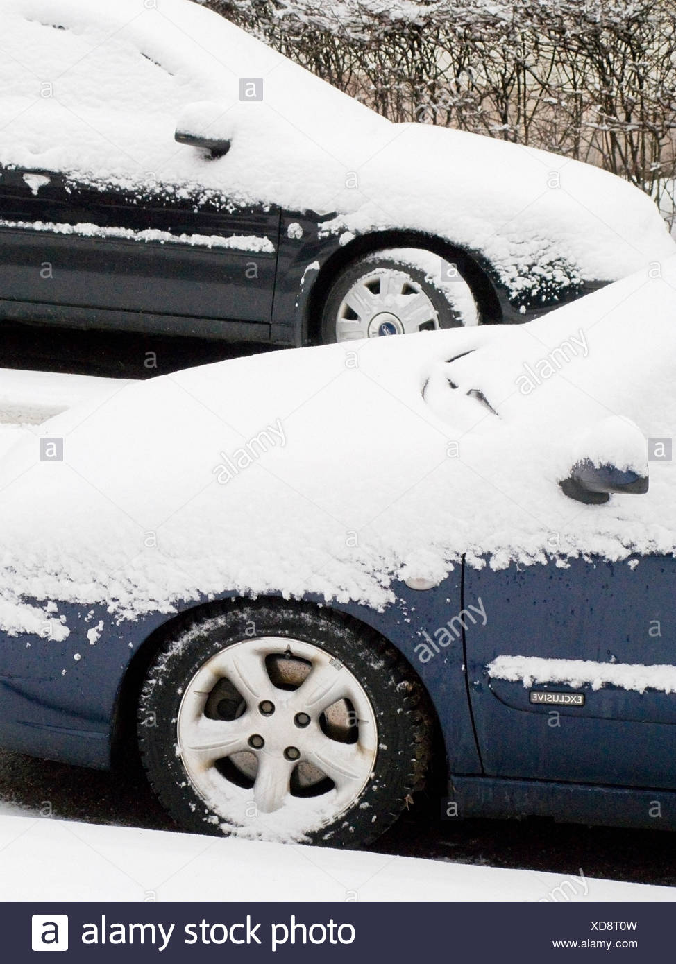 Cars covered in snow - Stock Image
