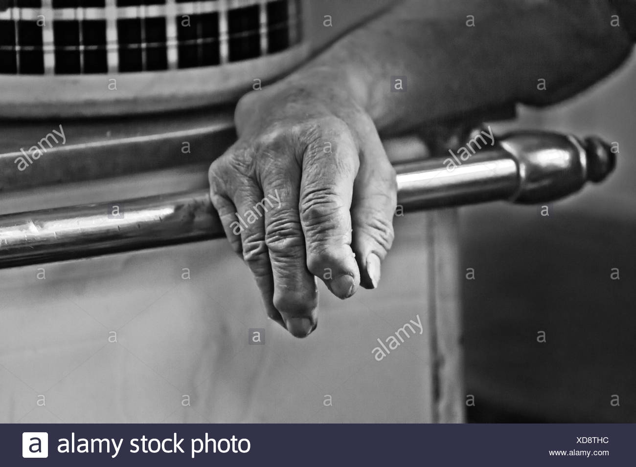 Hand of an old woman at the stove, b/w - Stock Image