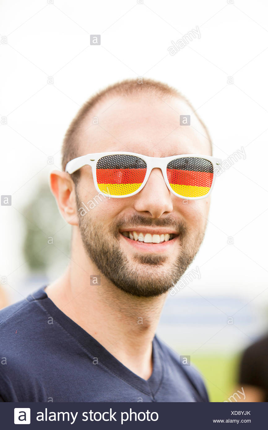 ad7c6fcc42f Young man wears eyeglasses with German colors Stock Photo  283553723 ...