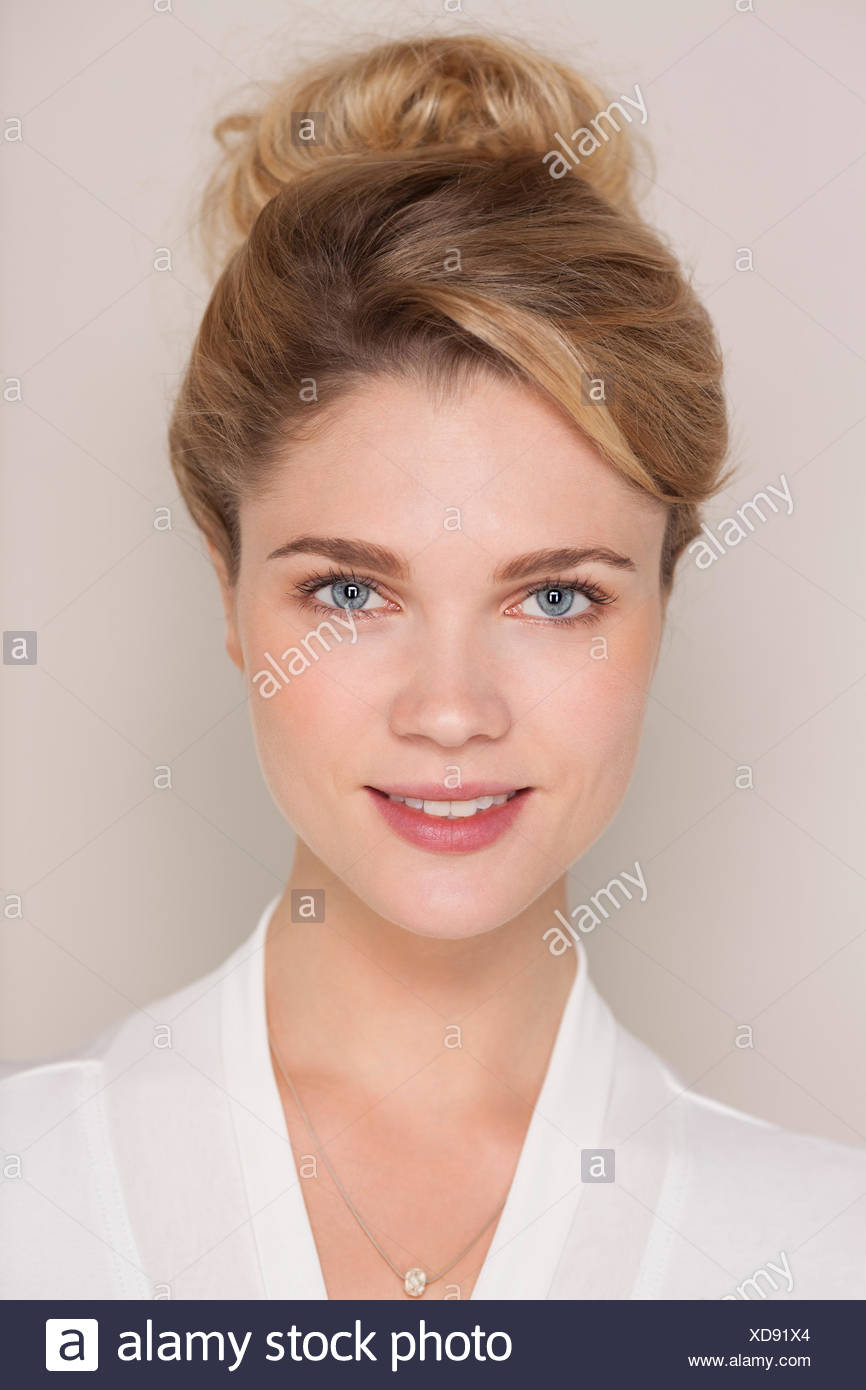 Portrait of a smiling woman in bathrobe - Stock Image