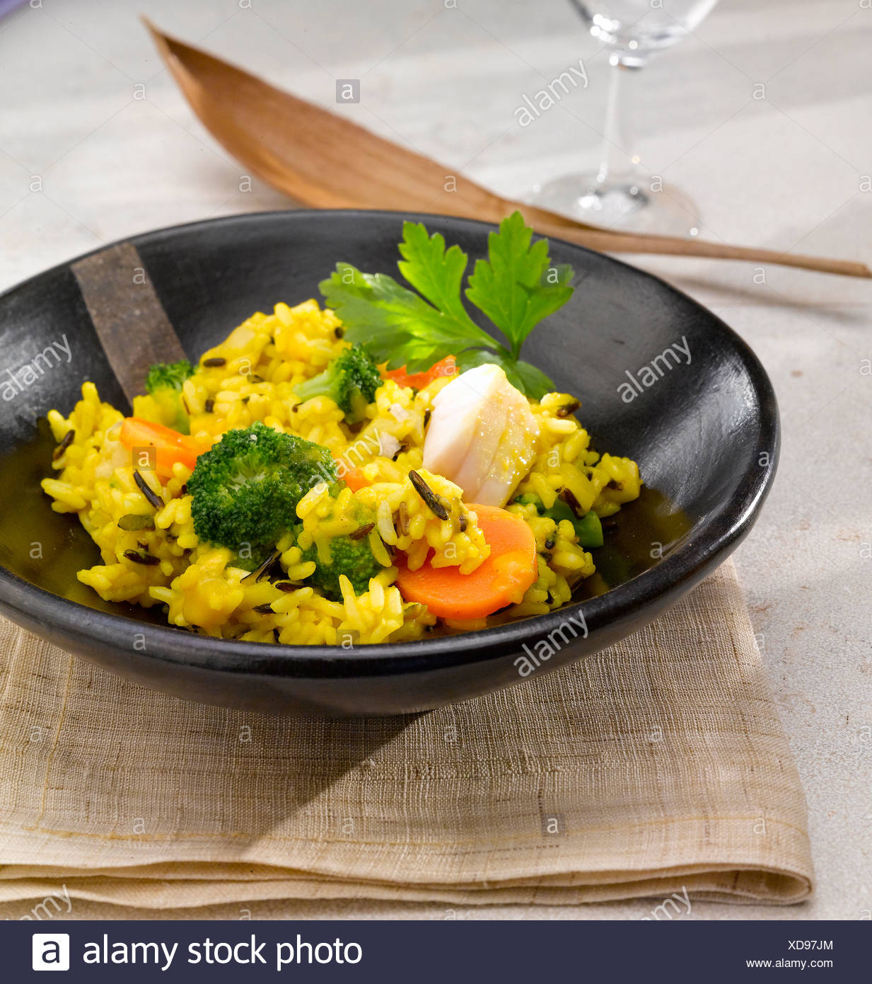 Curry dish in wooden bowl - Stock Image