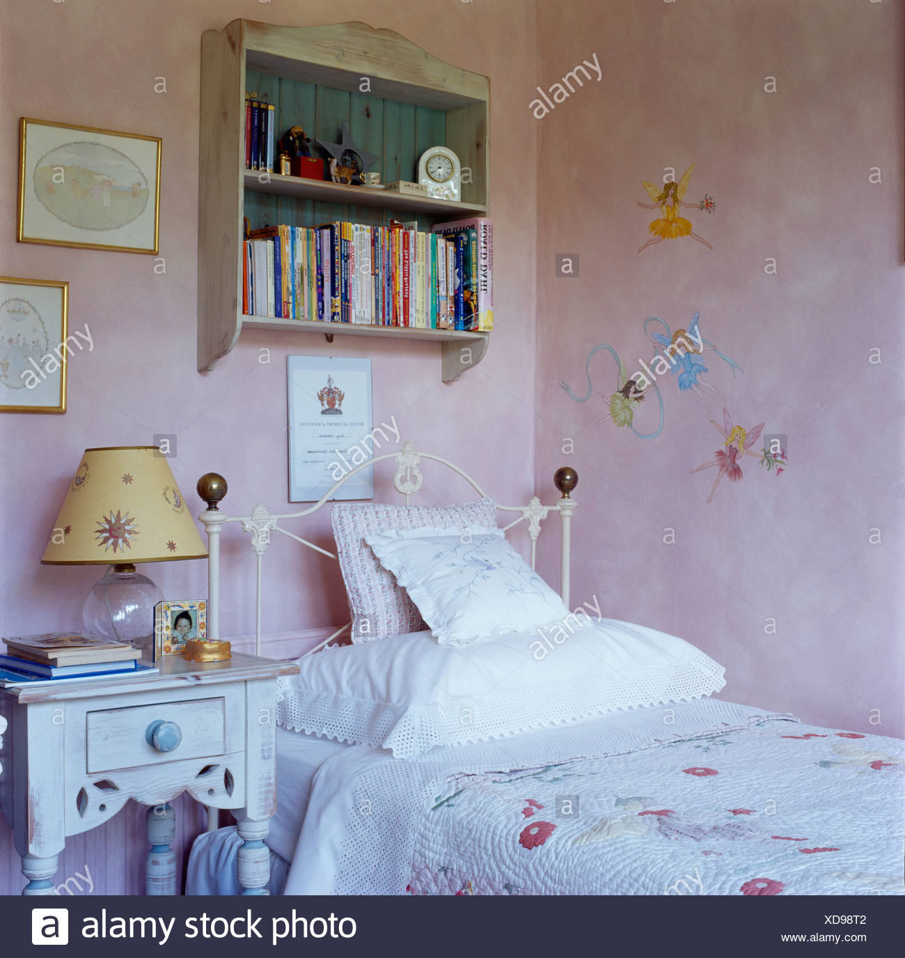 Small bookshelves on wall above white cast-iron bed in child's pink on harriet dawkins, mackenzie tucker, robin wimbiscus, comenic cuccinello iii, marisa tomei, matthew maxwell, sam johnson, robert demkowicz, cast maleficent, daniel baxter-leahy, gwendolyn gilchrist, cast that awkward moment, henry field, iris leslie, joseph field, ronald russell, erica towle-powers, jackie hagley, daniel hendricks, nichole wimbiscus, diane e. hamlin, justin ashforth, lisa carlton, owen thompson, nick stahl, hope berry, sara armstrong, rachel freeman, ryan ecker, cast mad max, parker spear, eric rahkonen, adah holman, shyann gauthier, andrea wright, dale johnson, rebecca benner, frank t. wells, william wise, joshua mills, jessie lanoue, philip spearing, jonathan walsh, veronica cartwright, christopher adams, cast crash, john campanello, tom wilkinson, deborah derecktor, daran norris, sam cousins, misty seekins, bill dawkins, cast death proof, brian hagley, tyler shane smith-campbell, natalie russell, francis mazzeo, jared mekin, bethany berry, erin barksdale, karen allen, don lewis, sissy spacek, chelsea peasley, elly barksdale, evanne weirich, william mapother, camden munson, elisabeth mcclure, harold withee, david blair, doug rich, shauneen grout, celia weston, alida p. field, andrea walker, ben staples, w. clapham murray, brandon carleton, kevin chapman, anna winsor, cast zero dark thirty, alicia laplant, cast american hustle, terry a. burgess,