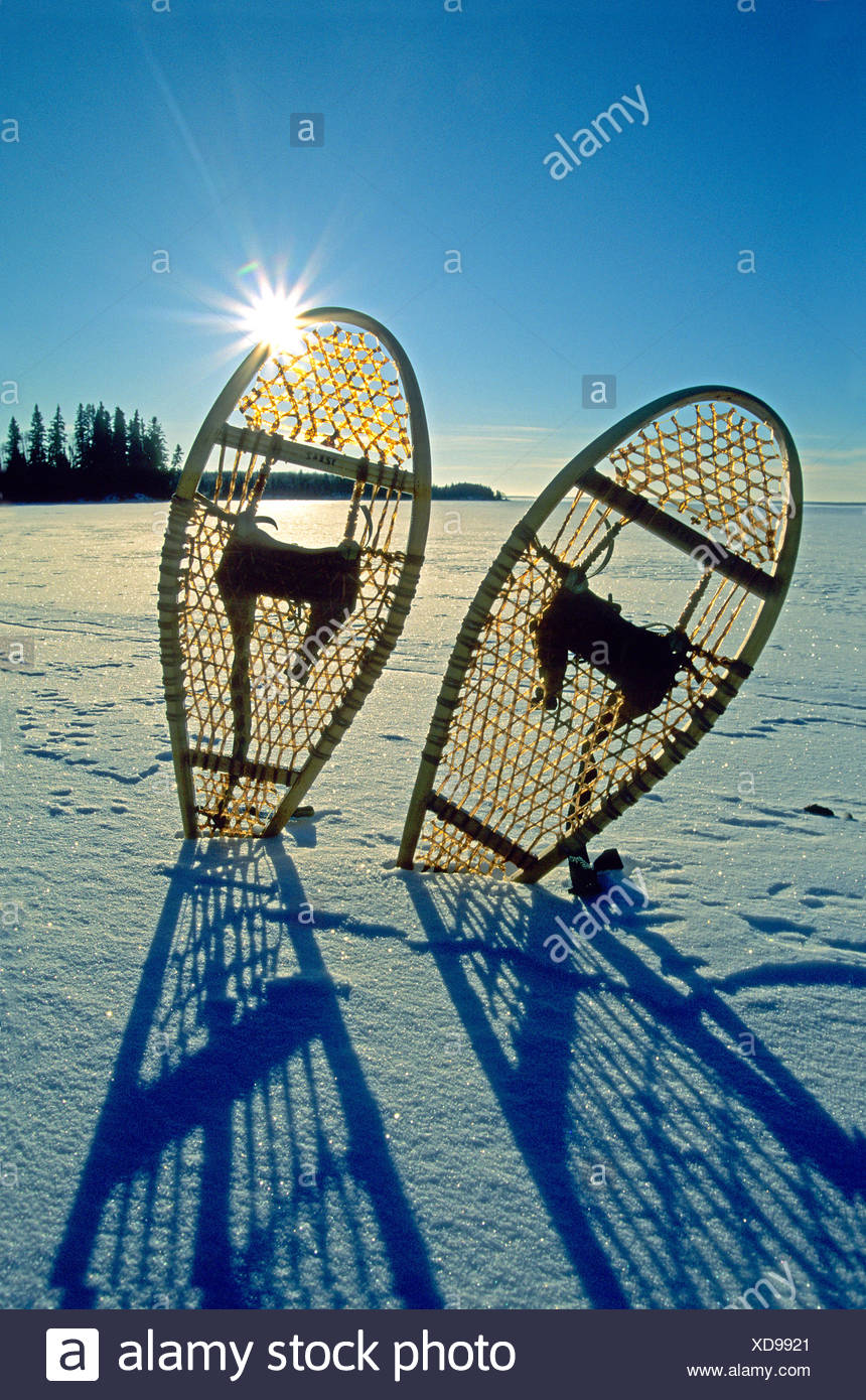Snowshoes on a frozen northern lake, Canada. - Stock Image