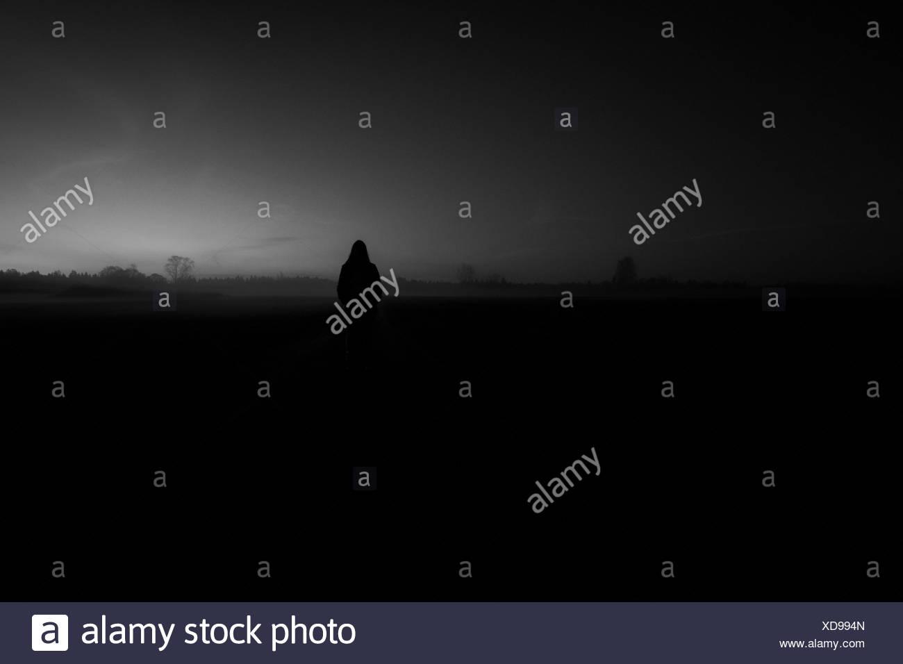 Long-exposure photography with woman at night and fog Stock Photo