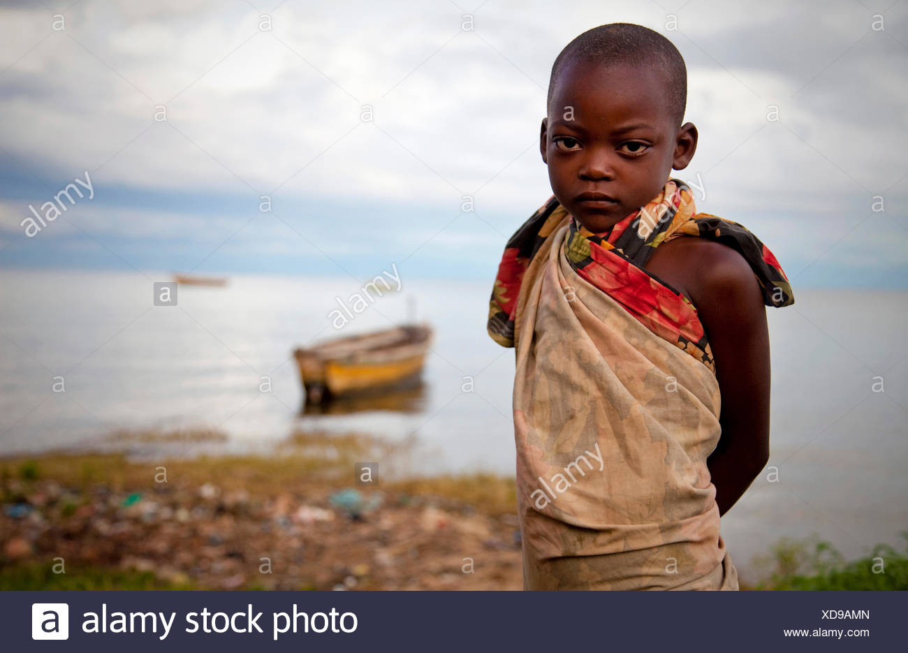 portrait of a young girl on the lakefront of Lake Tanganyika, Burundi, Makamba - Stock Image