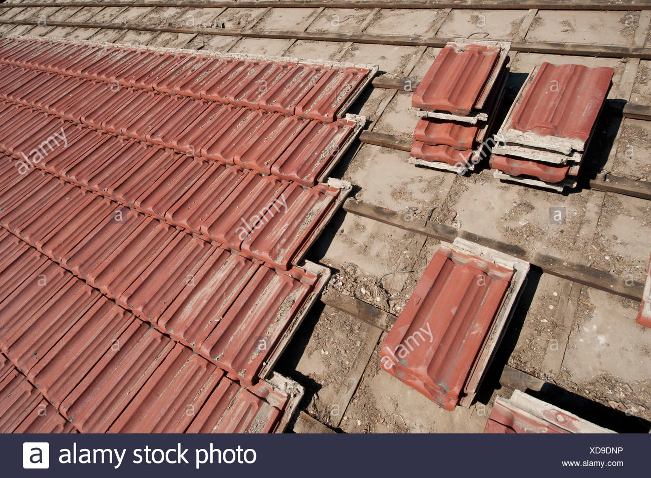 Salvaged roof tiles being removed from a roof in Lincoln, NE. - Stock Image