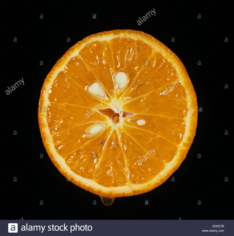 Cut section of mandarin fruit variety Sunburst - Stock Image