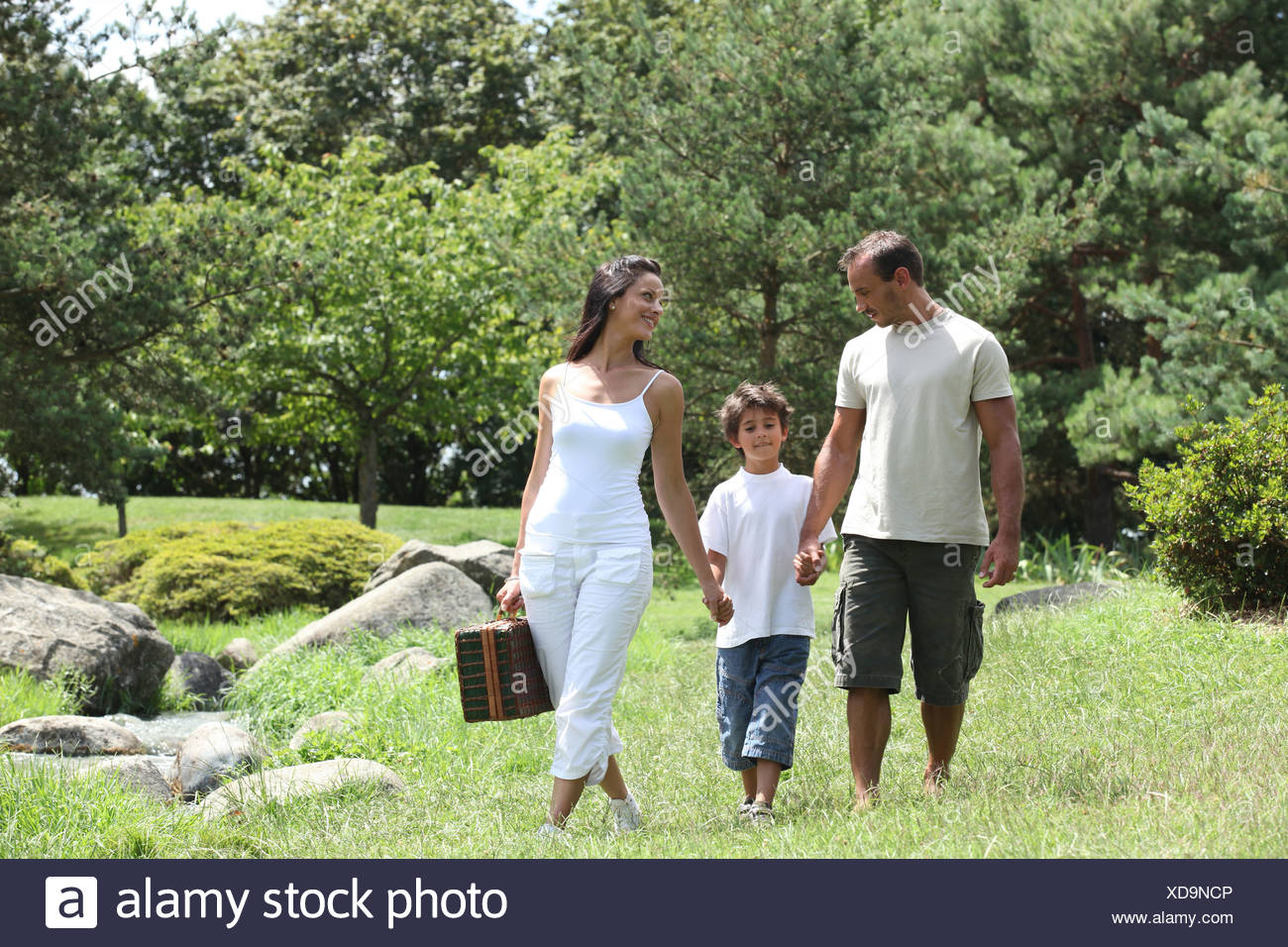 Family having picnic in the park - Stock Image