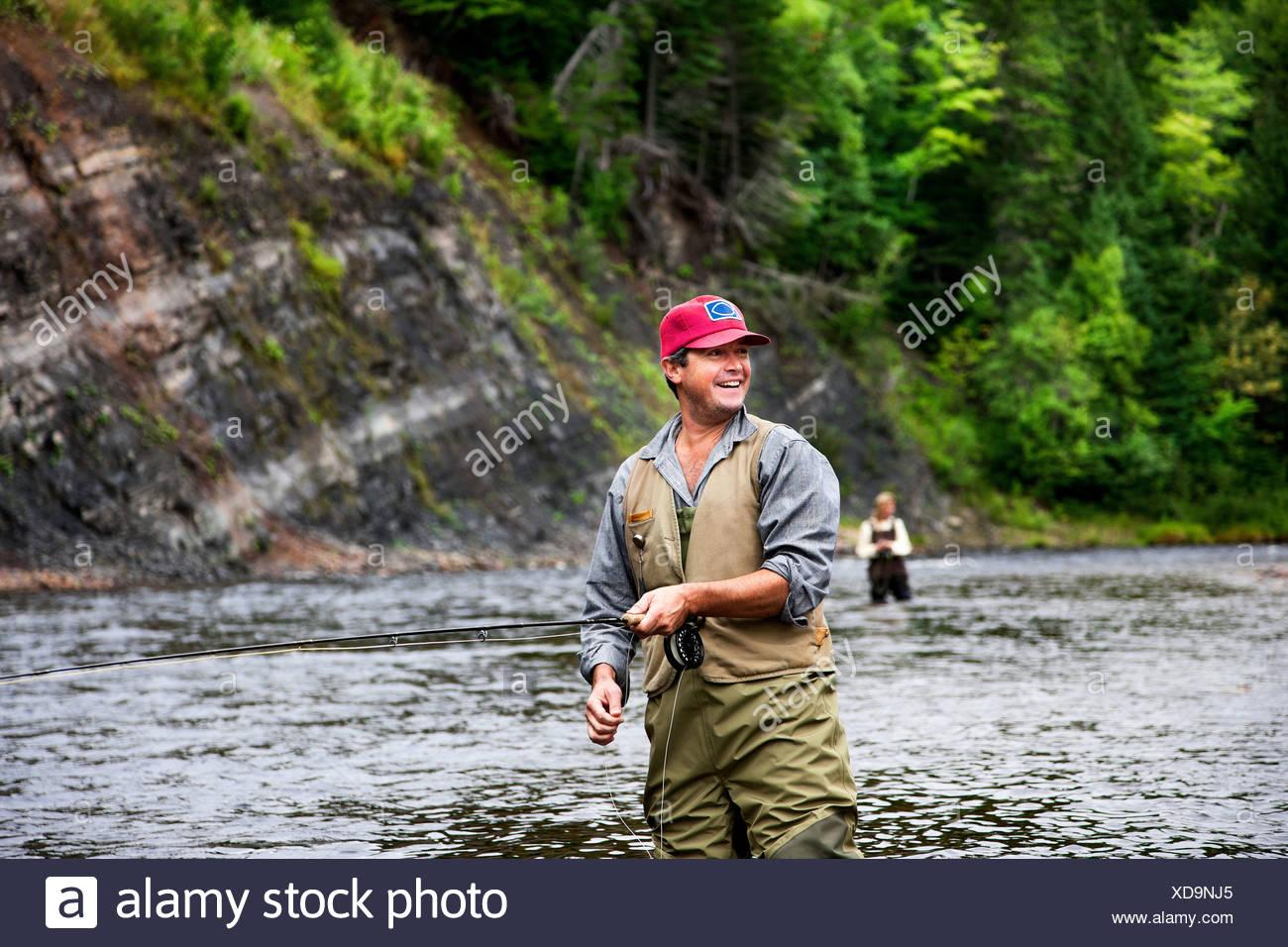 Fly fishers in Margaree River, Cape Breton Island, Nova Scotia - Stock Image