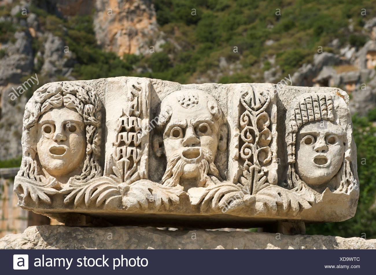 Turkish, Riviera, theatrical masks Myra, Lycia, south coast, Turkey, culture - Stock Image