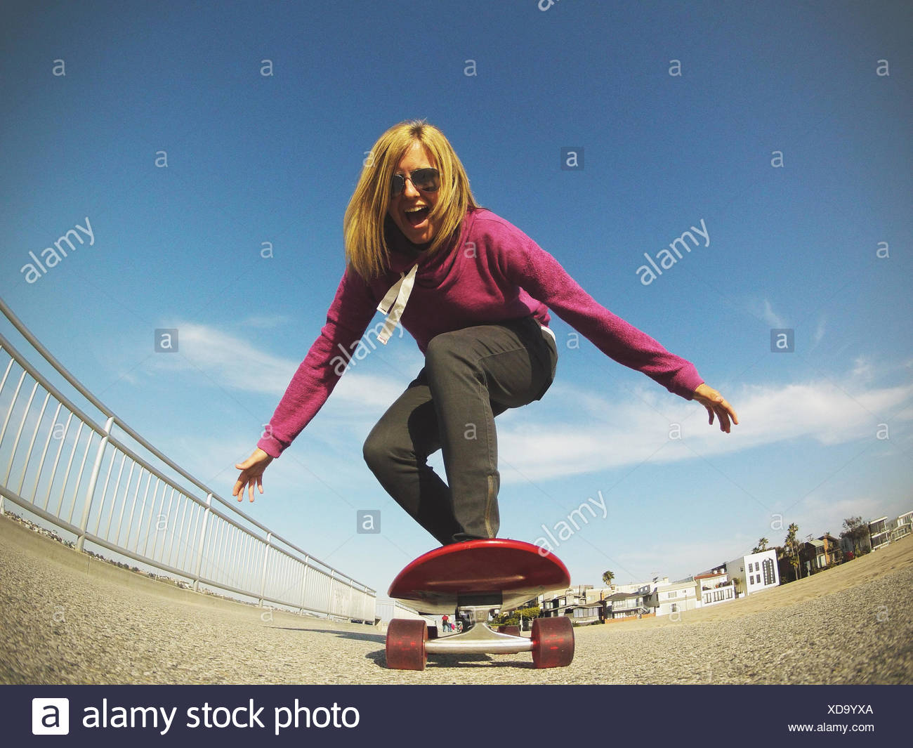 Young woman skateboarding, Los Angeles, California, America, USA - Stock Image