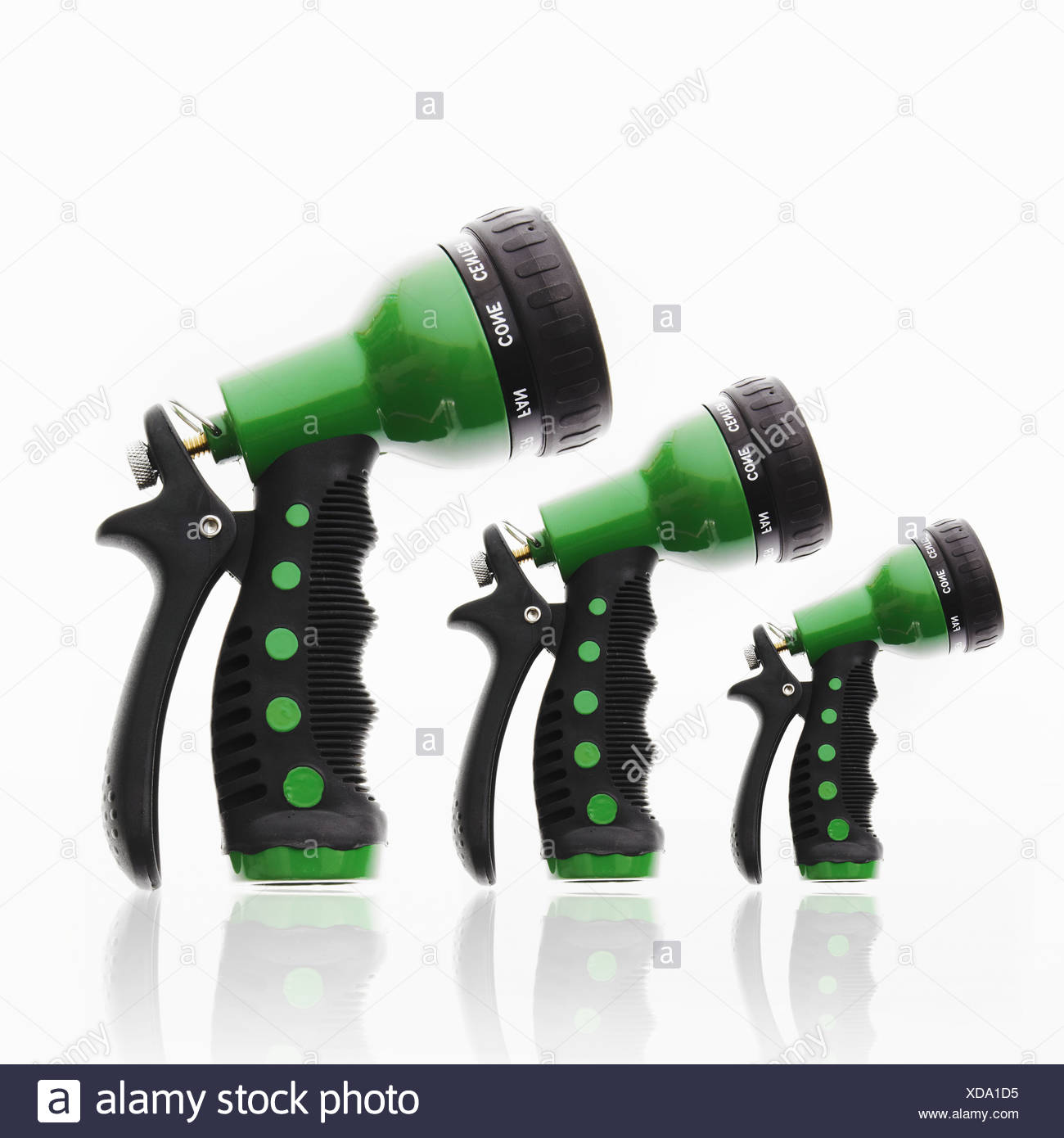 3 garden hose triggers nozzles in ascending size Stock Photo