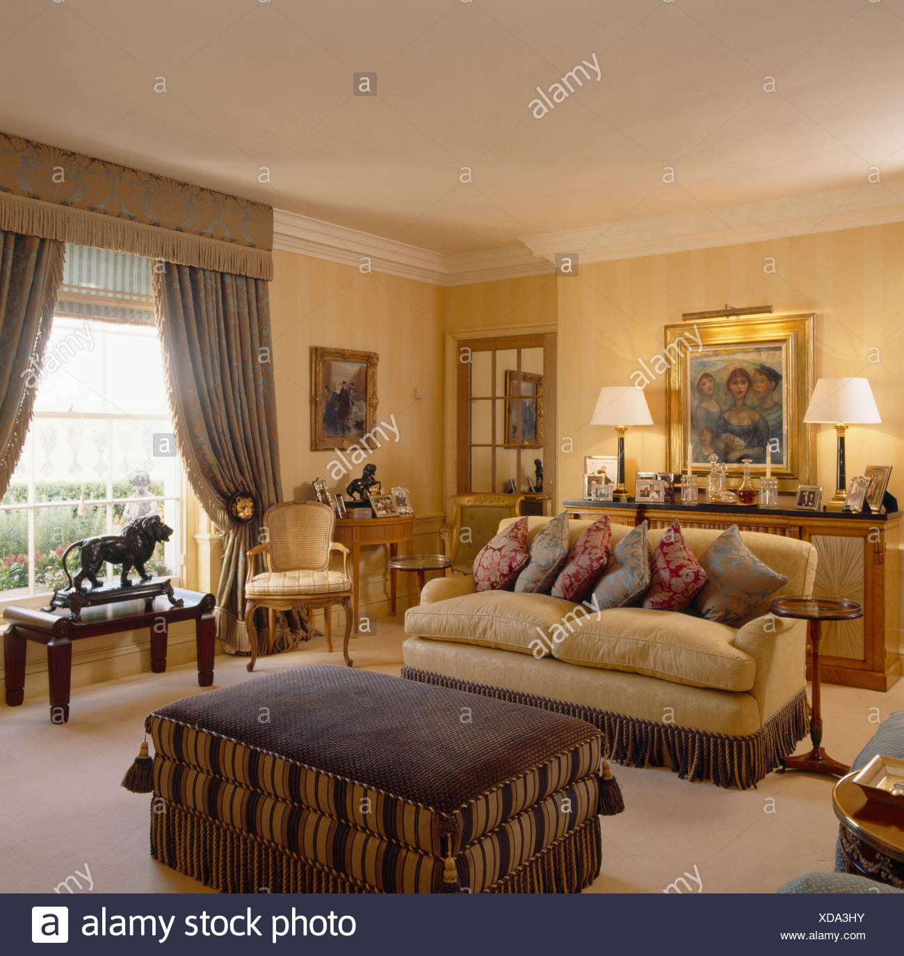 Comfy Cream Sofa Piled With Cushions In Living Room With