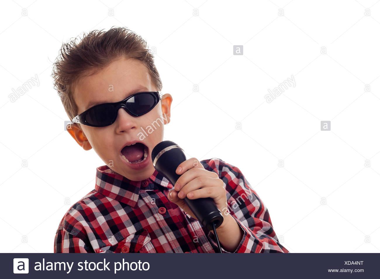 boy singing loud - Stock Image