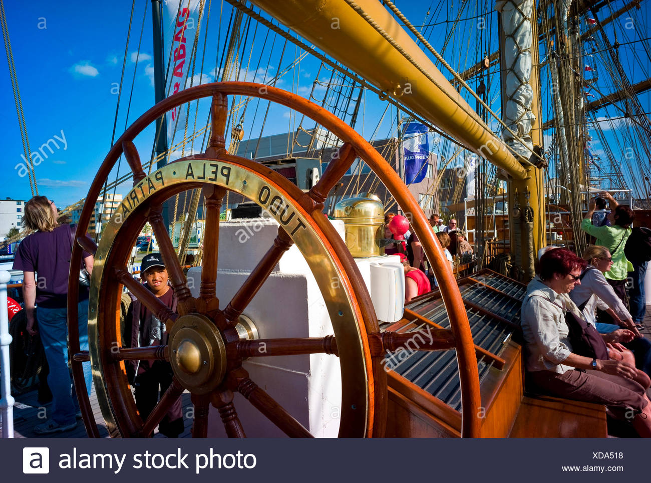 wheel of a training ship 'Cisne Branco' with tourists on board - Stock Image