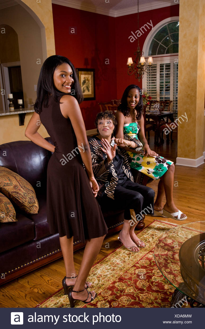 American Home Makeover african american teenage girl at home with family stock