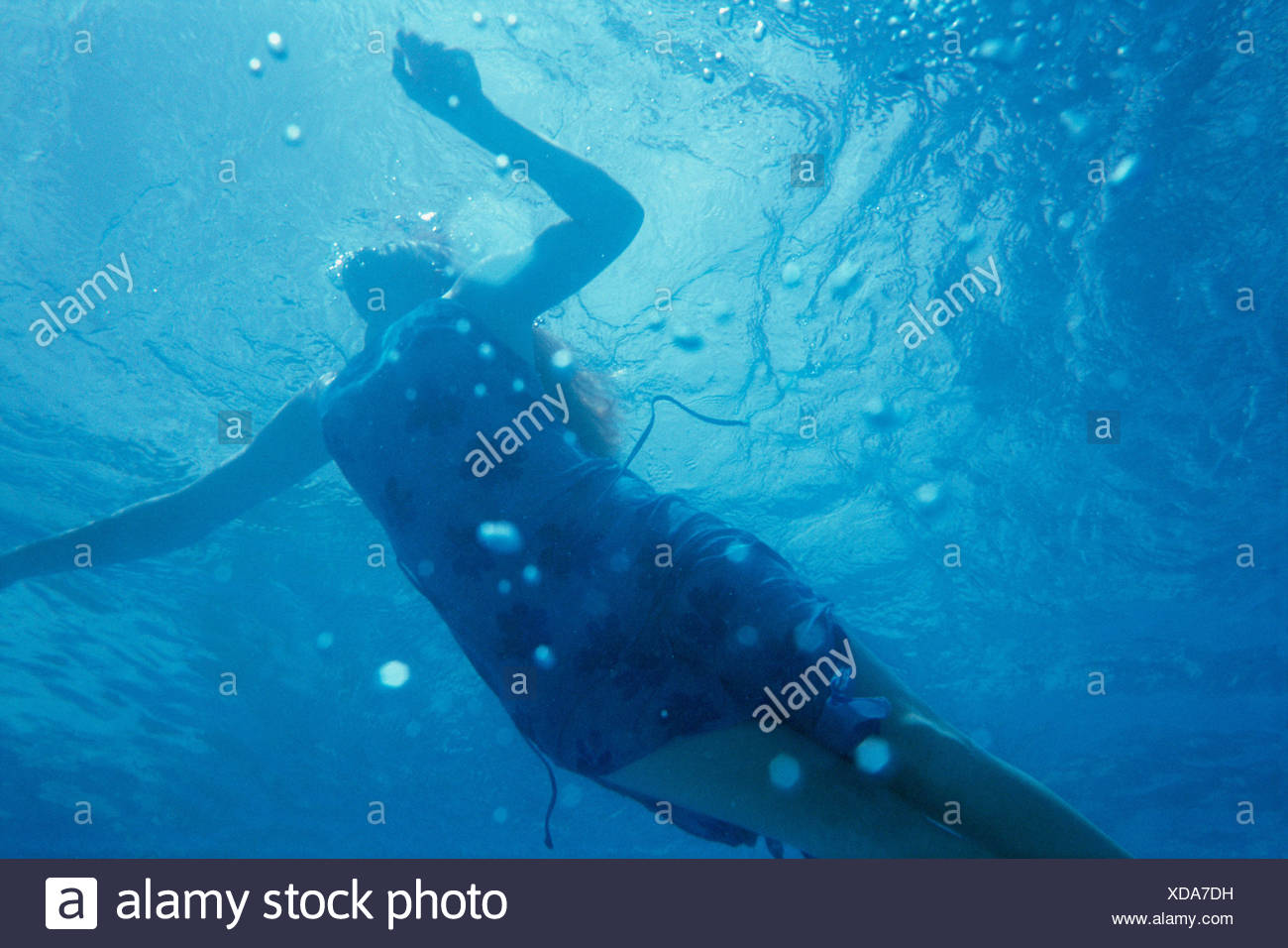 A woman taking a breather - Stock Image