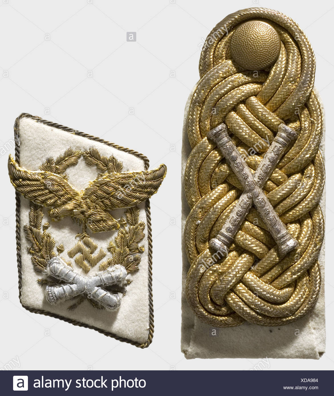 A separate collar patch and shoulder board, for a Luftwaffe Field Marshal Collar patch of fine white cloth with surrounding gold cord piping, oak leaf wreath, and separatly applied eagle in the finest gold embroidery, with silver-embroidered, raised, crossed marshal's batons. Shoulder board intertwined of three parallel round golden cords, bearing crossed silver marshal's batons, stamped in very fine detail. White backing. Extremely rare insignia for the highest rank in the Luftwaffe, only awarded six times. According to the consignor, these pieces come from th, Additional-Rights-Clearences-NA - Stock Image