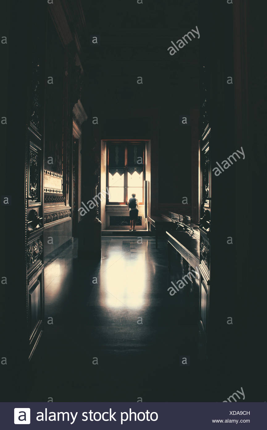 Woman Looking Through Window - Stock Image