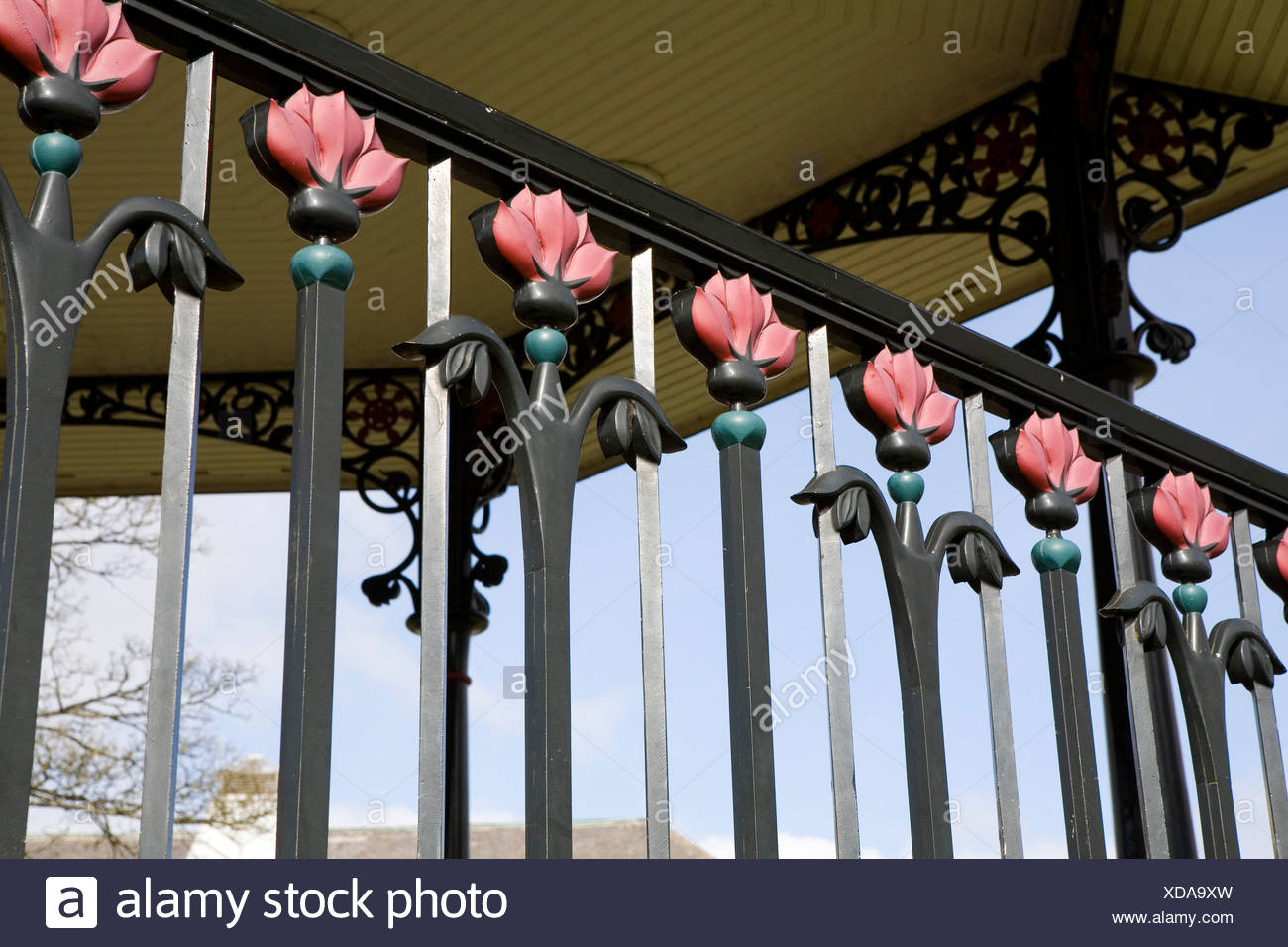 England, Derbyshire, Buxton, floral wrought-iron bandstand railings in Pavilion Gardens - Stock Image
