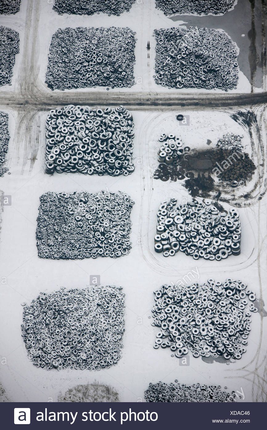 Aerial view, used tires storage, scrap tire recycling, snow, winter, Hervest, Dorsten, Ruhrgebiet area, North Rhine-Westphalia, - Stock Image