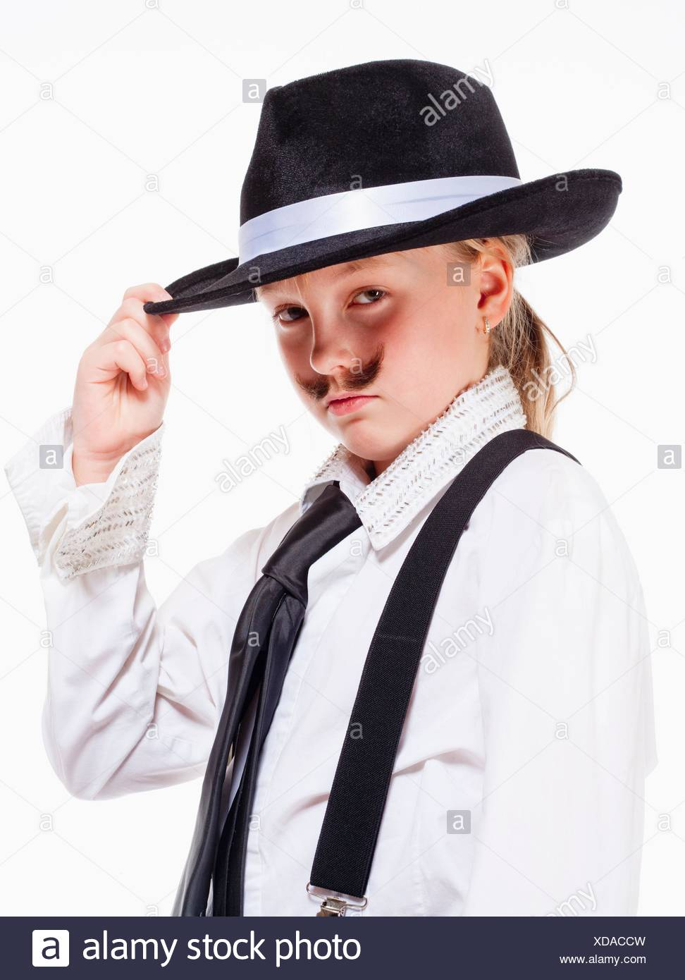 Portrait of a Little Girl with Hat Posing as a Gangster. - Stock Image