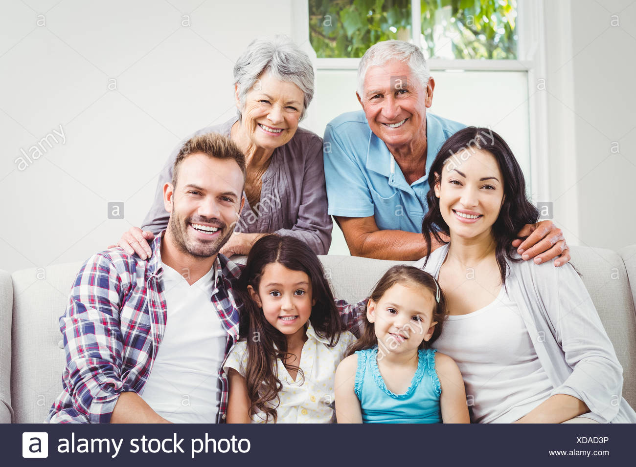 Portrait of happy multi generation family - Stock Image