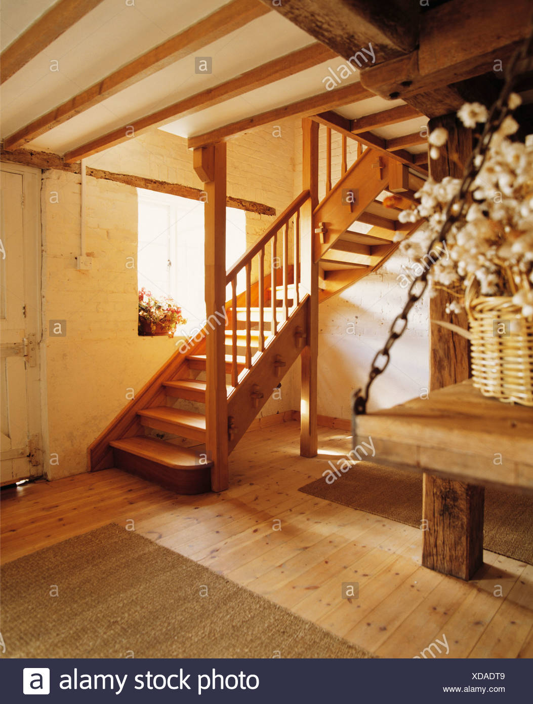 Wooden Open Tread Staircase In Cream Cottage Hall With Wooden Flooring    Stock Image