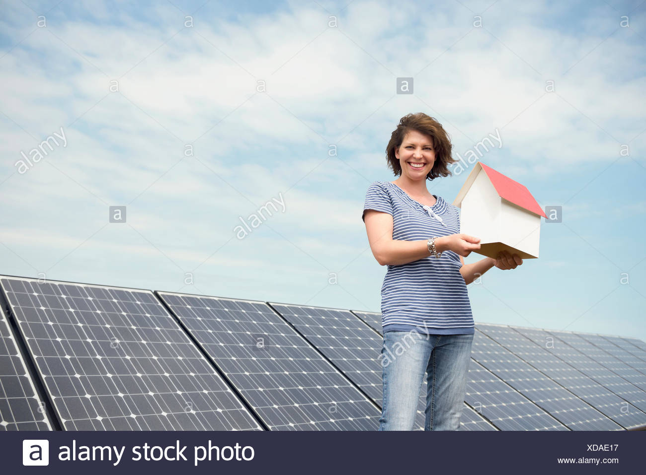 Woman Holding Small Model House Solar Energy Stock Photo