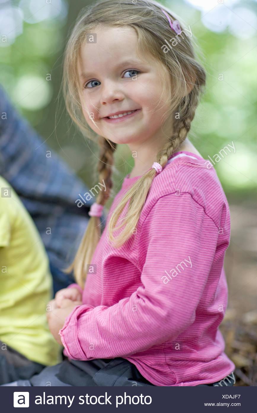 Kindergarten child smiling in a wood kindergarten - Stock Image