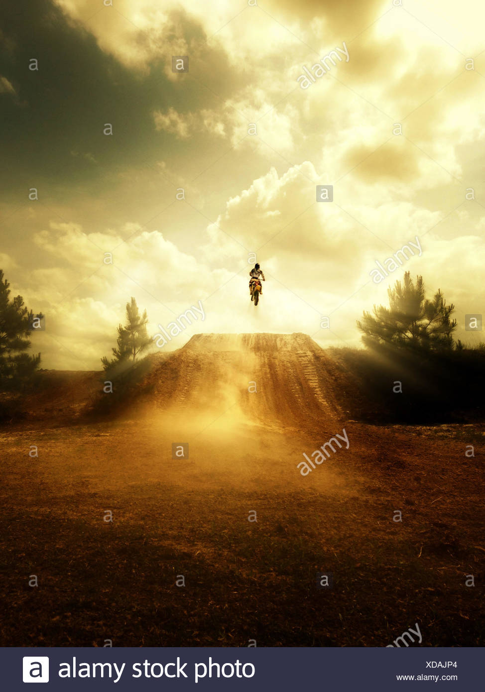 USA, Florida, Clay County, Green Cove Springs, Person jumping on motorcycle - Stock Image
