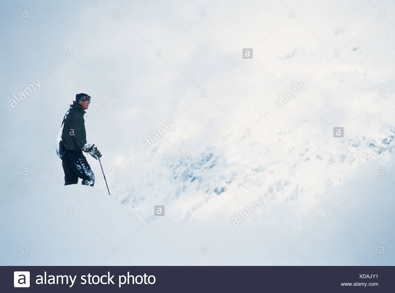 Skier taking in the view on massive slopes high above Chamonix Valley. Stock Photo