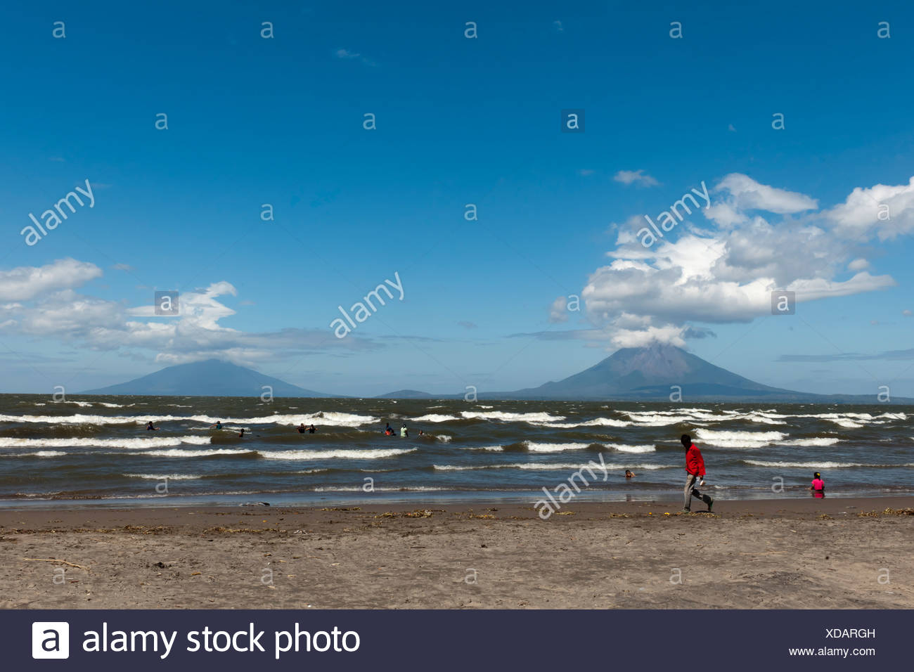 Shallow shore of the Lago de Nicaragua with the volcanic island of Ometepe and the stratovolcanoes Volcán Concepción, left Stock Photo