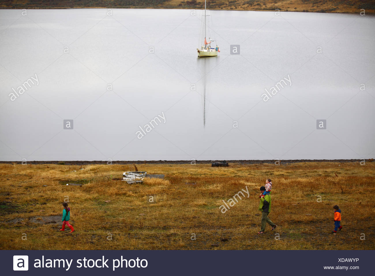 A family walks along the Eberhard fjord in a pasture near Puerto Prat, Chile. - Stock Image