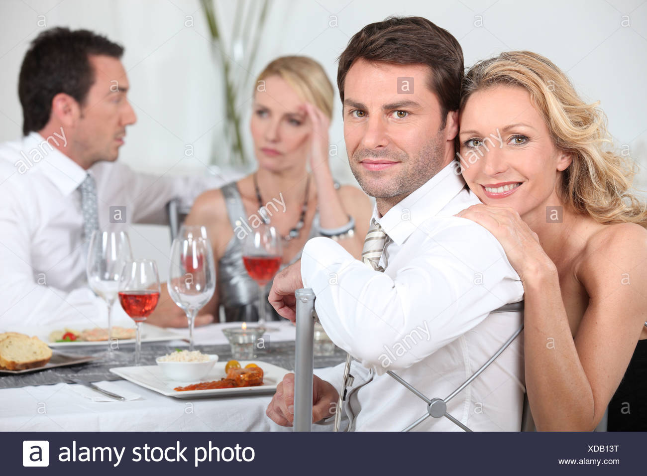 Dinner party discussions - Stock Image