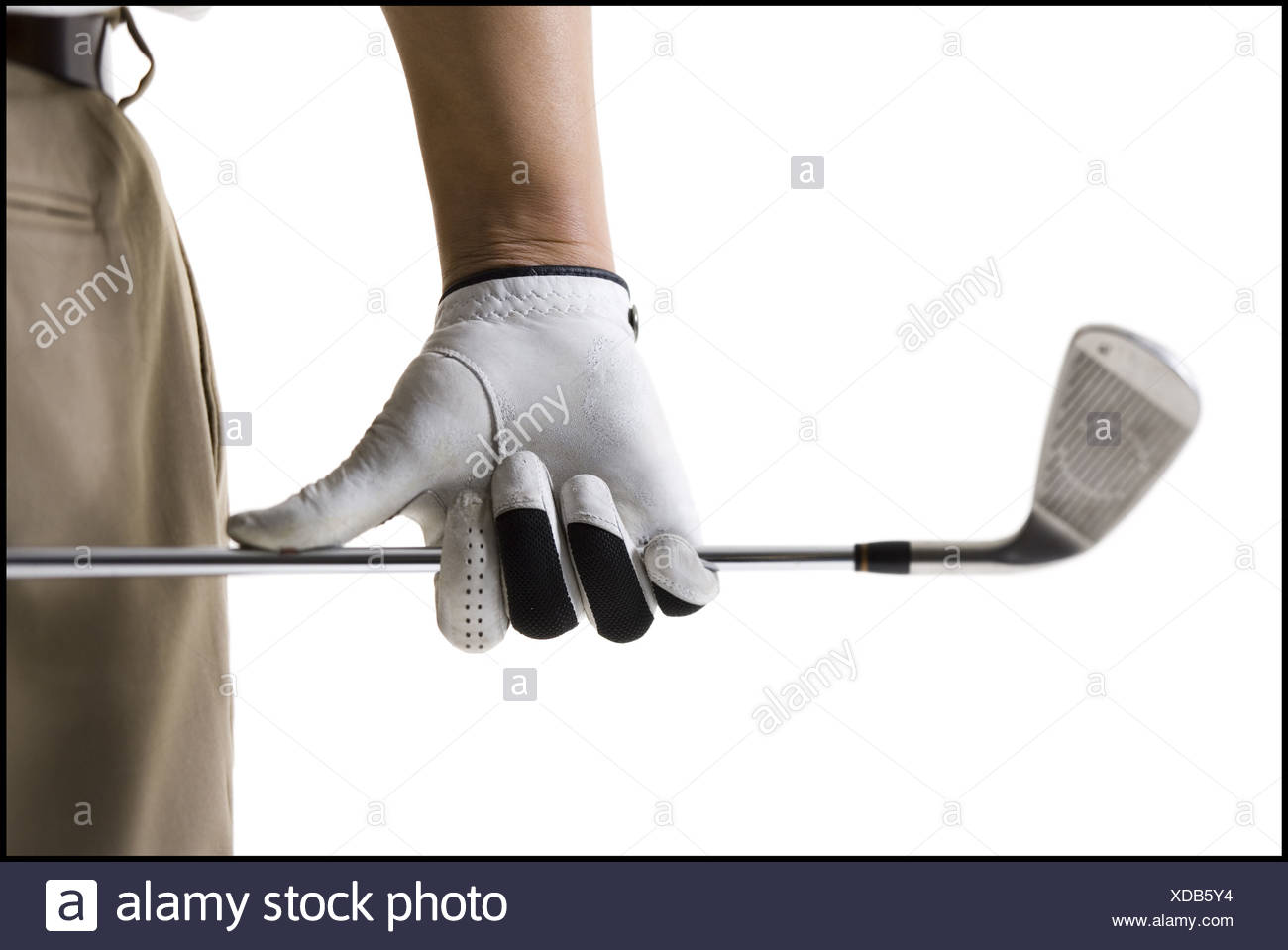 Golfer with club - Stock Image