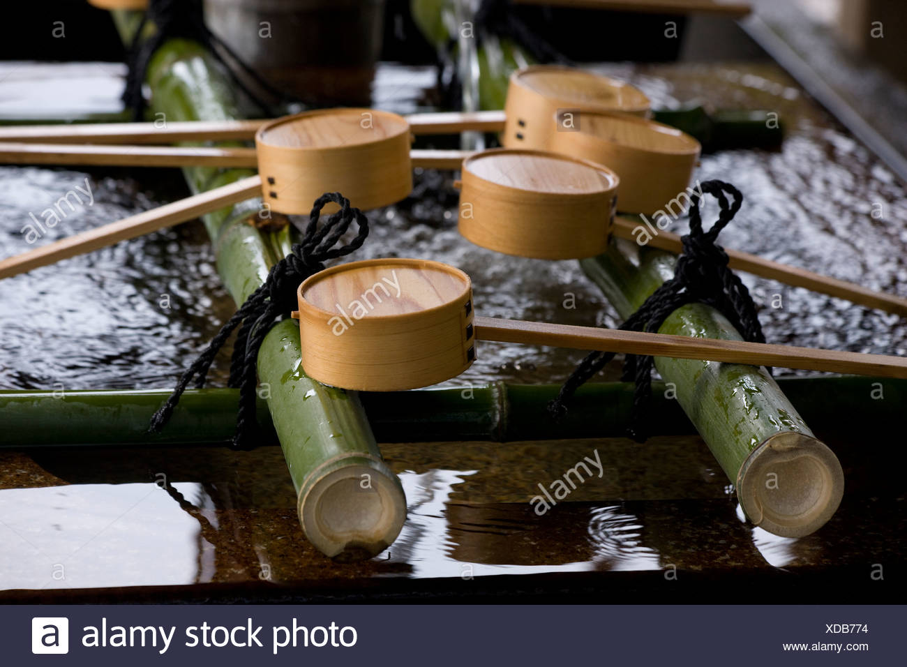 Ceremonial hand washing ladles - Stock Image