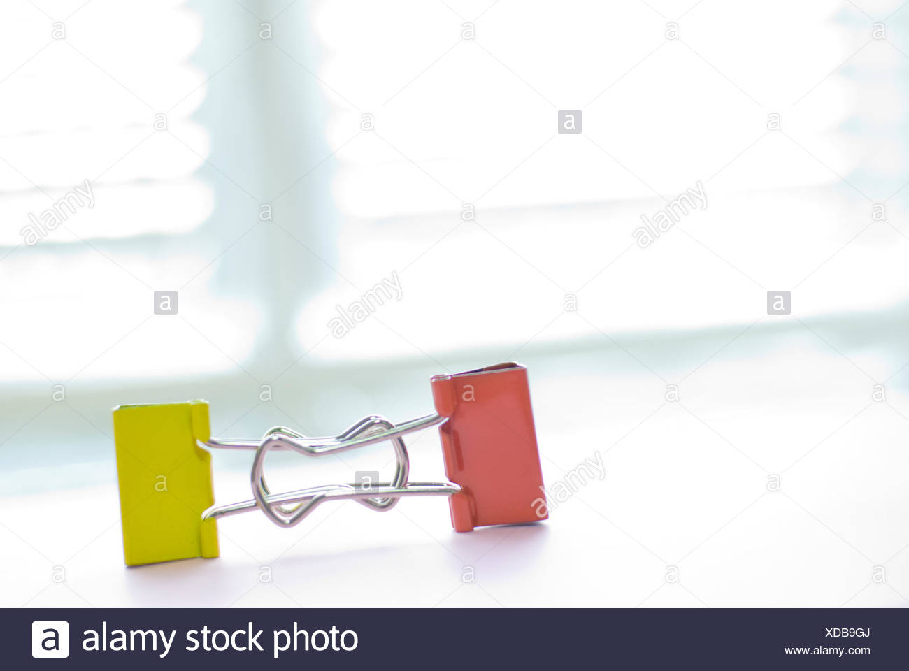 Colorful binder clip - Stock Image