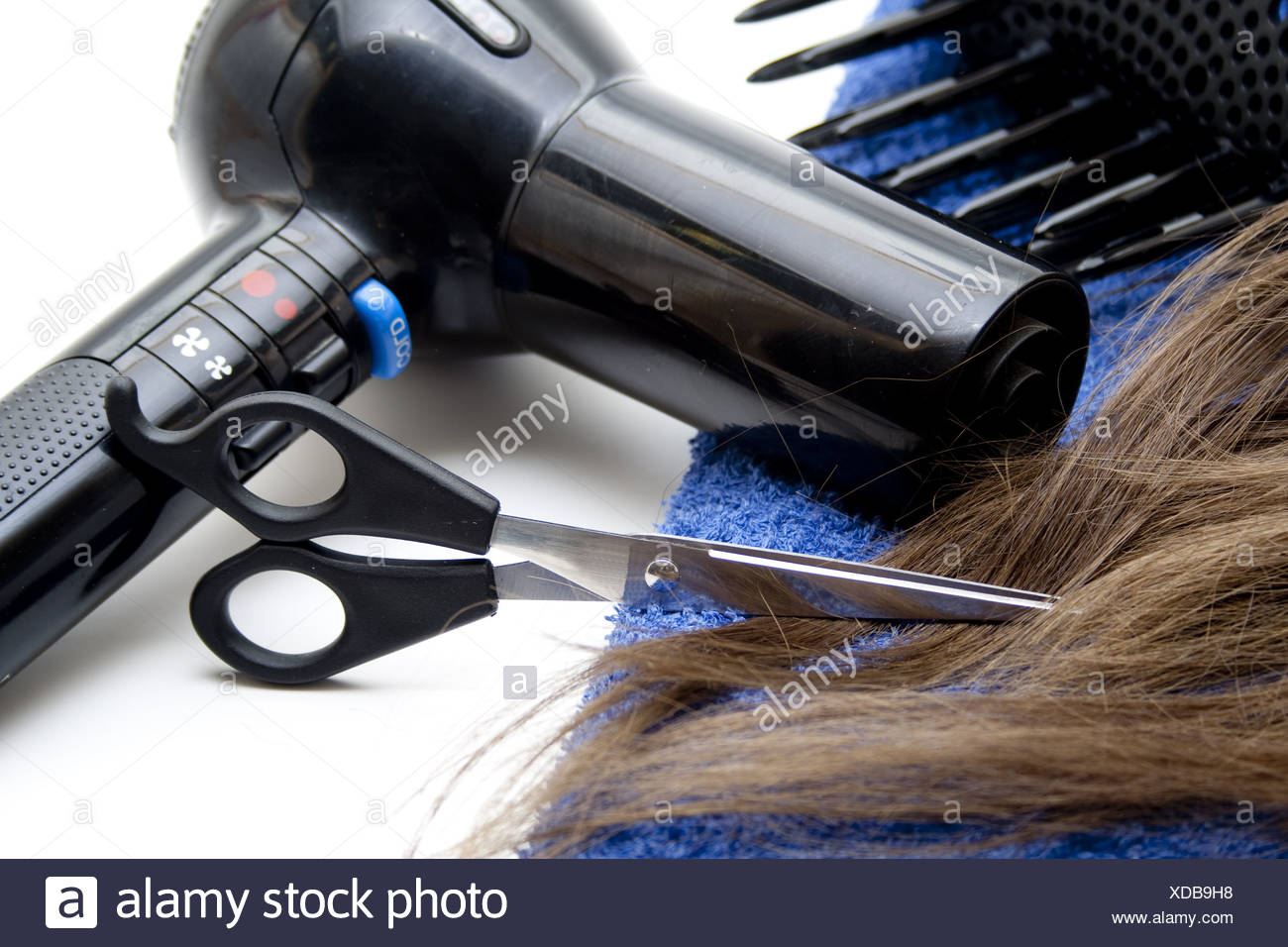 Hairdrier with scissors - Stock Image