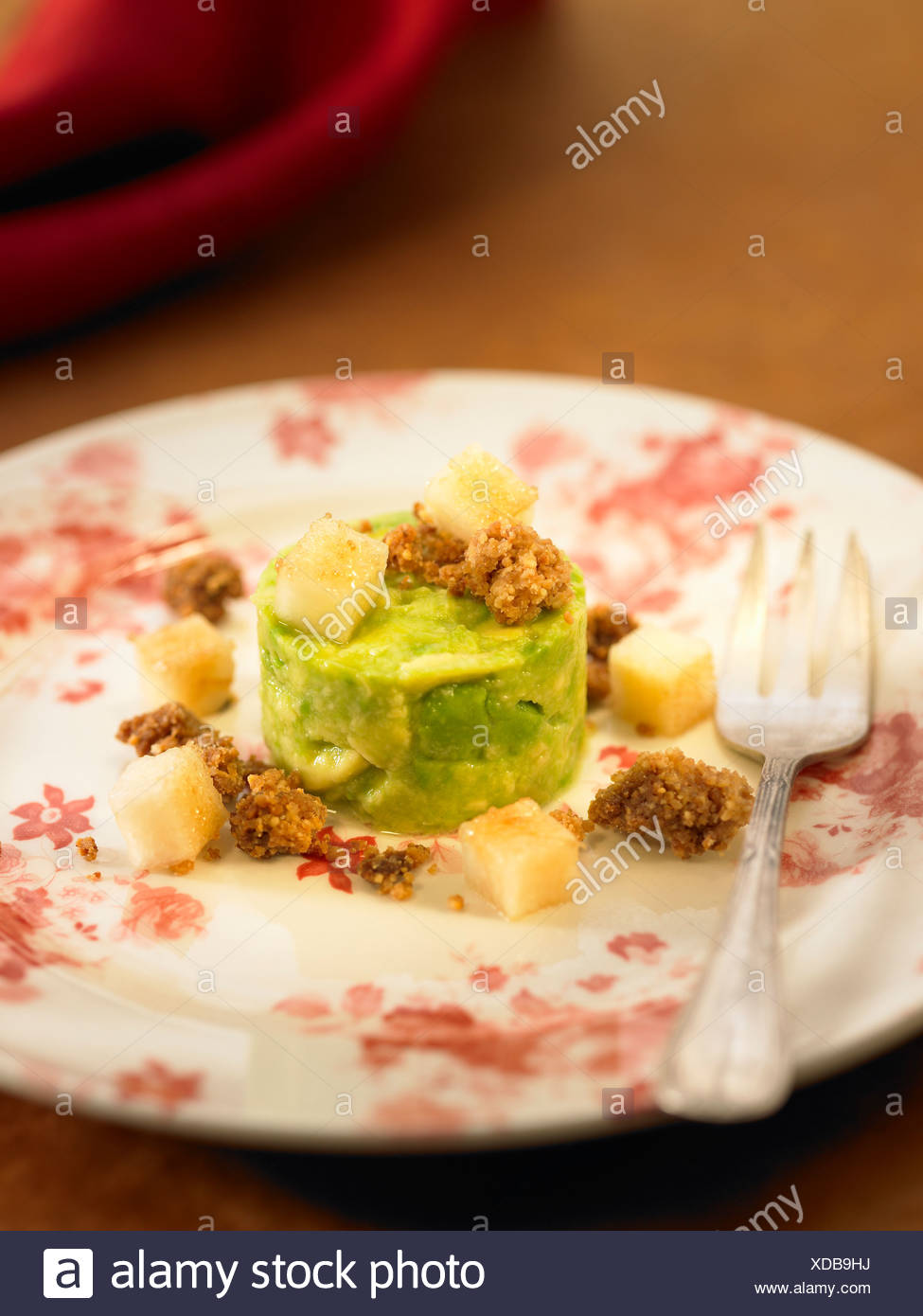 Avocado and citrus fruit tumbler with diced pears and lime juice - Stock Image