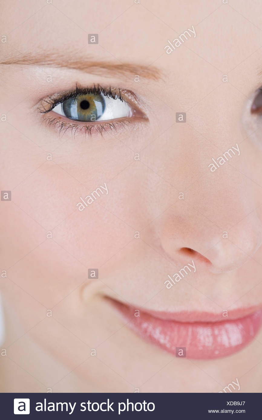 Close-up of a woman's face, left side - Stock Image