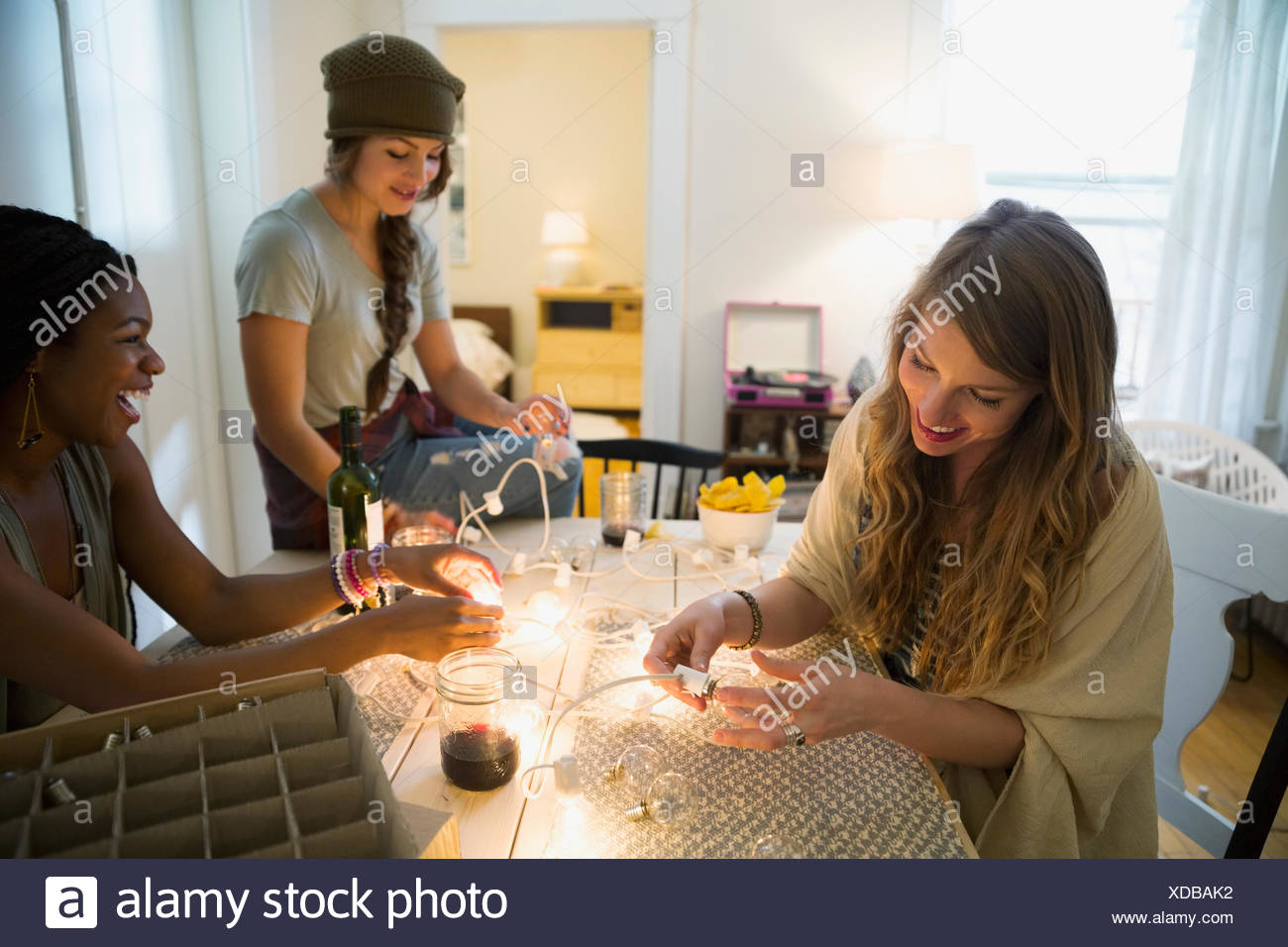 Friends preparing string lights - Stock Image