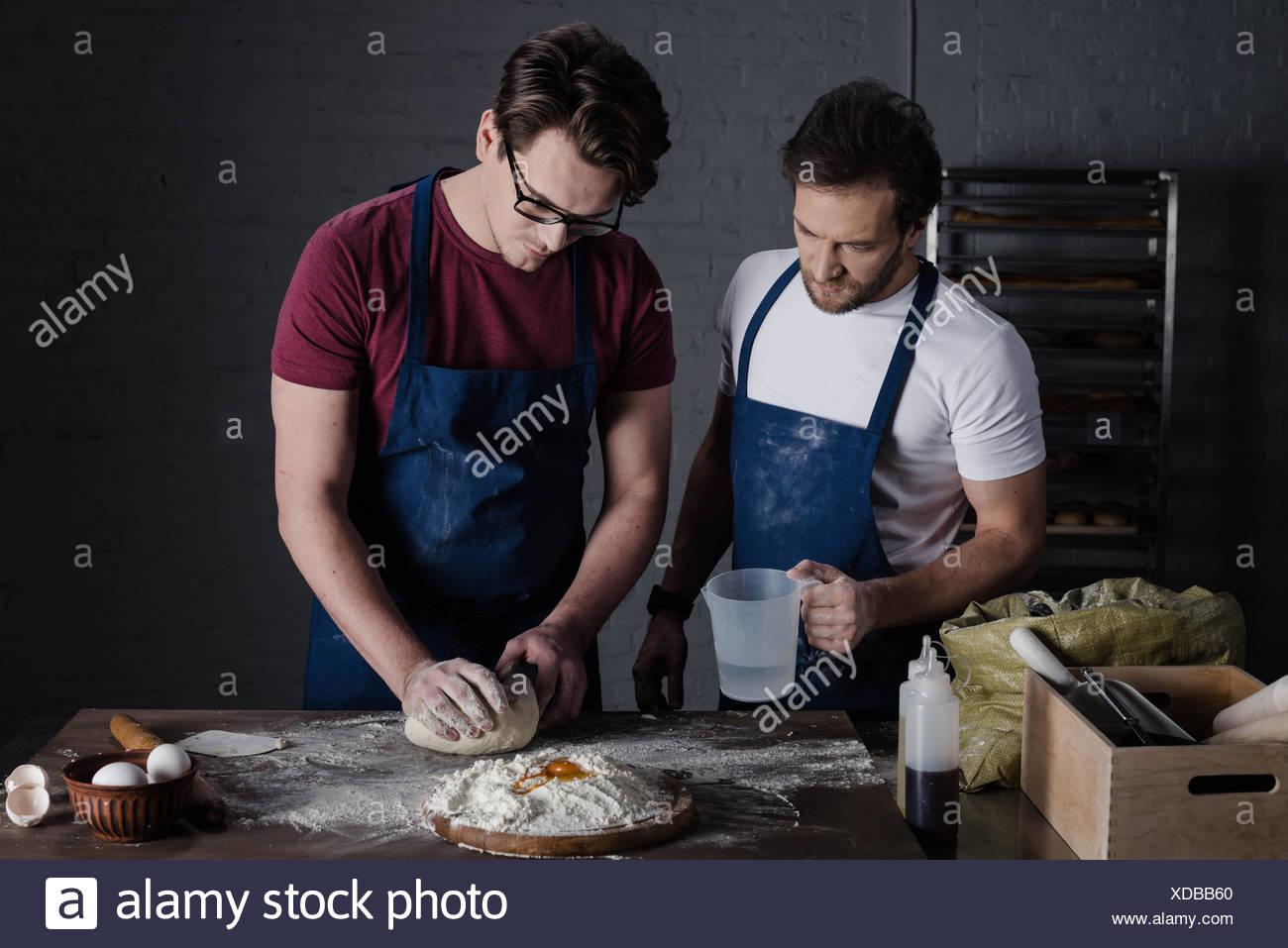 Bakers preparing dough - Stock Image