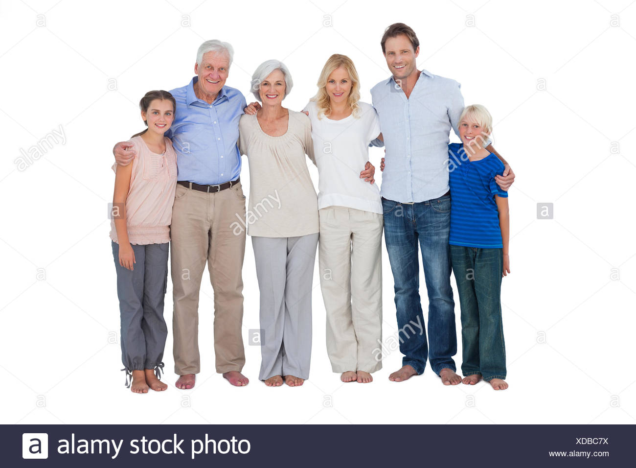 Family standing against a white background Stock Photo